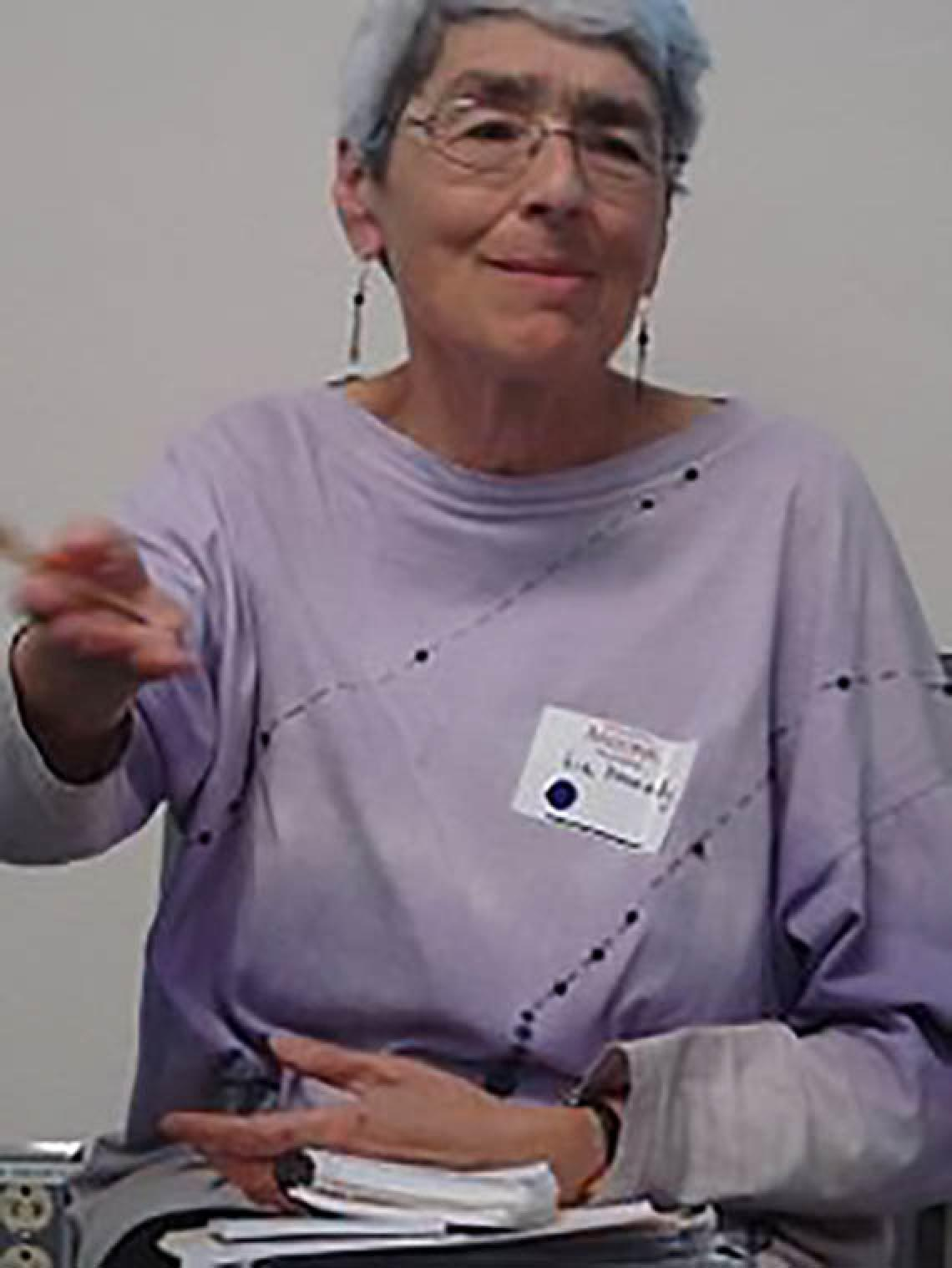 Dr. Liz Kennedy moving hands while speaking